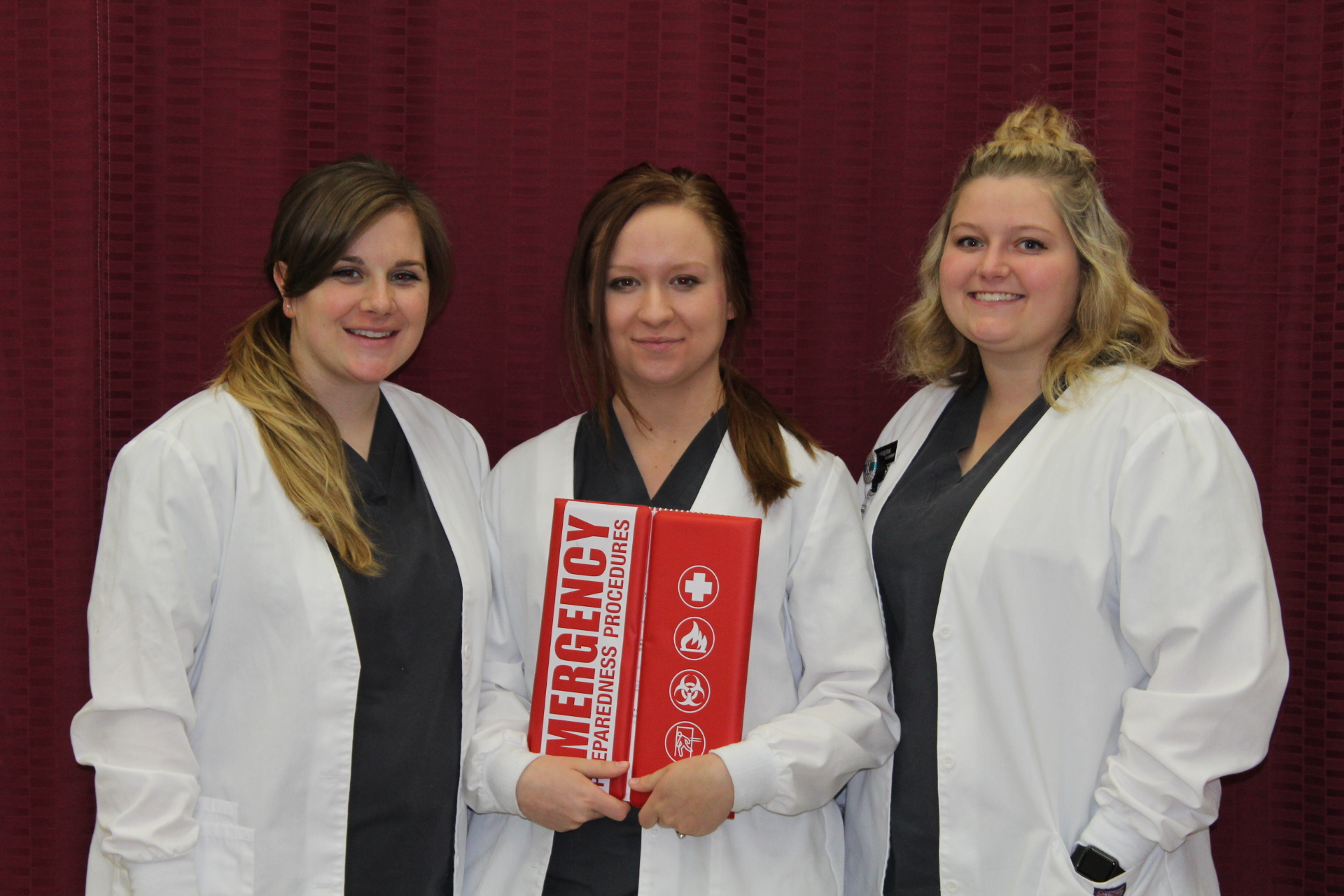 Photo of three medical assistant students